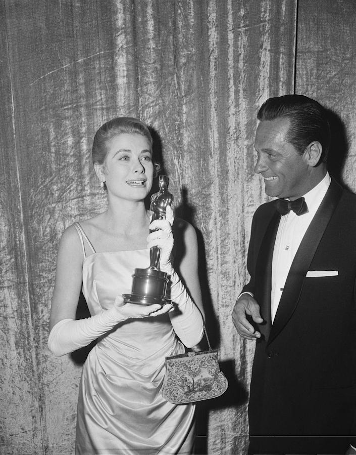 <p>With her Oscar for Best Actress in <em>The Country Girl</em> in 1955.</p>