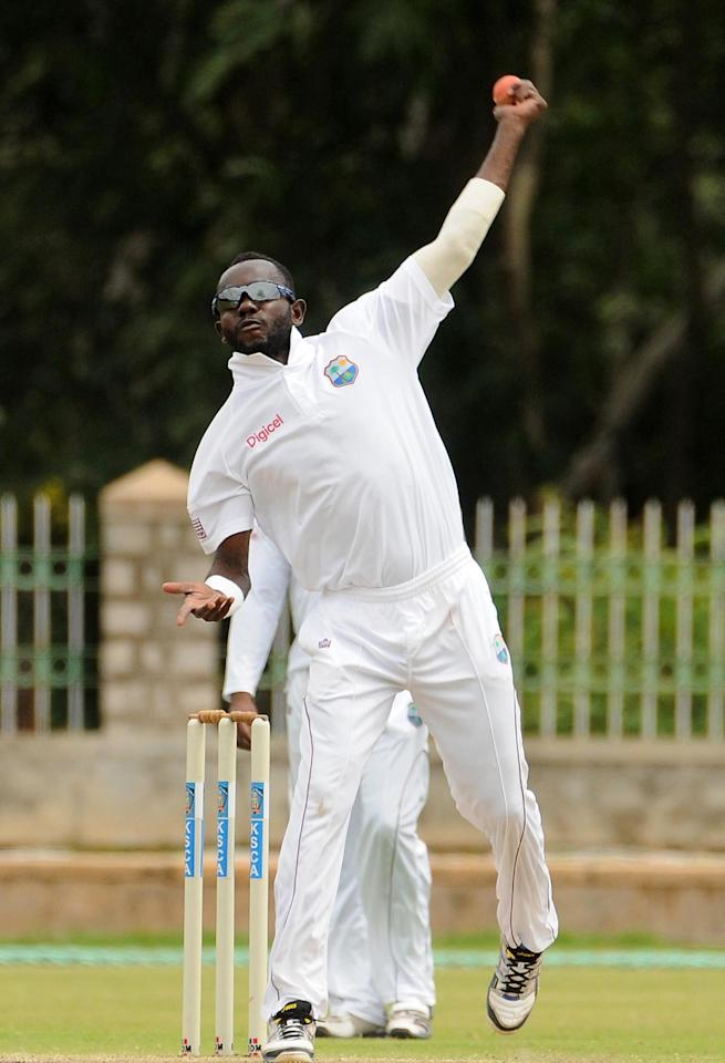 Nikita Miller bowls on Day 4 of first unofficial Test between West Indies A and India A at the Gangothri Glades Cricket Ground in Mysore on Sept. 28, 2013. (Photo: IANS)