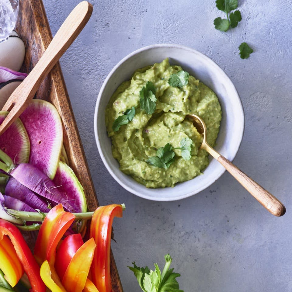 """<p>Guacamole meets chickpeas for a Cali-Middle East mashup in this healthy avocado hummus recipe. Jalapeños can be hot or not so much--taste and adjust for your palate. <a href=""""http://www.eatingwell.com/recipe/273372/spicy-avocado-hummus/"""" rel=""""nofollow noopener"""" target=""""_blank"""" data-ylk=""""slk:View recipe"""" class=""""link rapid-noclick-resp""""> View recipe </a></p>"""