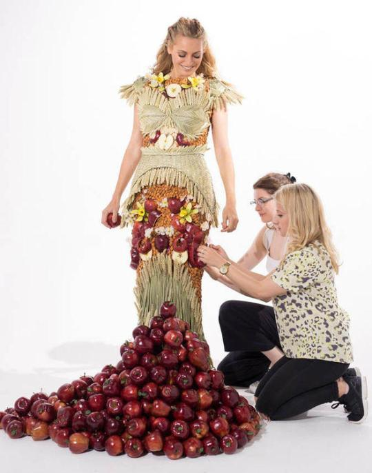 """<p>Co-designed by UK TV personality Tess Daly, this cereal-inspired gown took over 200 hours to make, and includes 4,000 stalks of wheat, 500 whole almonds, 800 cut almonds, 50 vanilla pods, 50 vanilla flowers, 450 whole apples, and 100 curled apple peels, preserved peels, and apple slices—representing all the ingredients that go into Special K. As for how *wearable* the dress is? Well… that's a whole 'nother story.<a href=""""https://twitter.com/MySpecialK_UK"""" rel=""""nofollow noopener"""" target=""""_blank"""" data-ylk=""""slk:"""" class=""""link rapid-noclick-resp""""><br></a></p>"""
