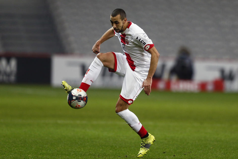 Dijon's Fouad Chafik controls the ball during the French League One soccer match between Lille and Dijon at the Stade Pierre Mauroy stadium in Villeneuve d'Ascq, northern France, Sunday, Jan. 31, 2021. (AP Photo/Michel Spingler)