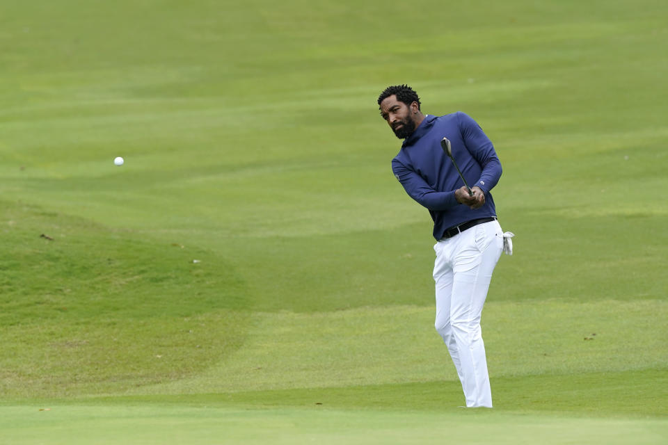 North Carolina A&T's J.R. Smith hits onto the 18th green during the first round of the Phoenix Invitational golf tournament in Burlington, N.C., Monday, Oct. 11, 2021. Smith, who spent 16 years in the NBA made his college golfing debut in the tournament hosted by Elon. (AP Photo/Gerry Broome)