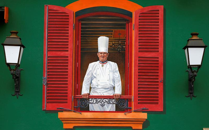 The Michelin guide has sparked a furore among French chefs and critics for docking Paul Bocuse's famed restaurant in Lyon a third star - REUTERS