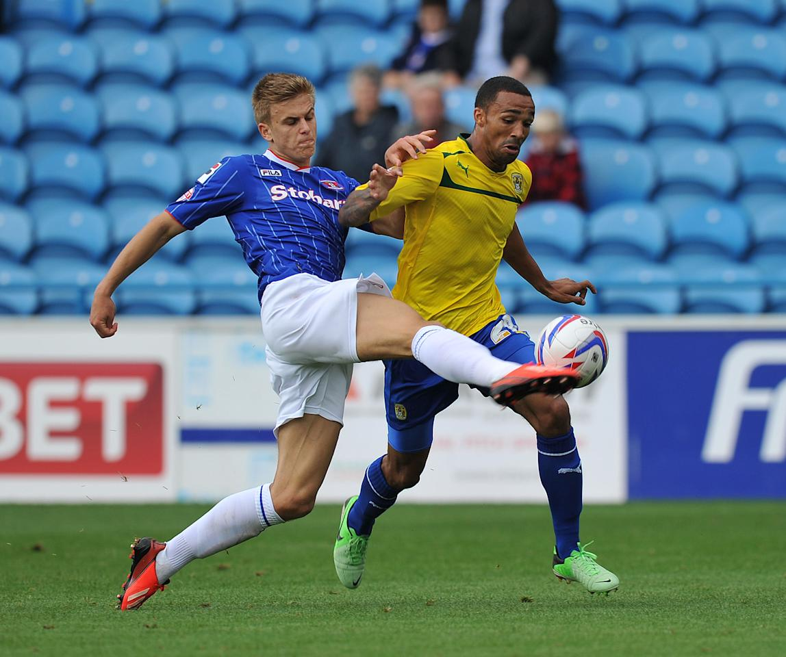 Carlisle United's Brad Potts and Coventry City's Callum Wilson battle for the ball during the Sky Bet Football League One match at Brunton Park, Carlisle.