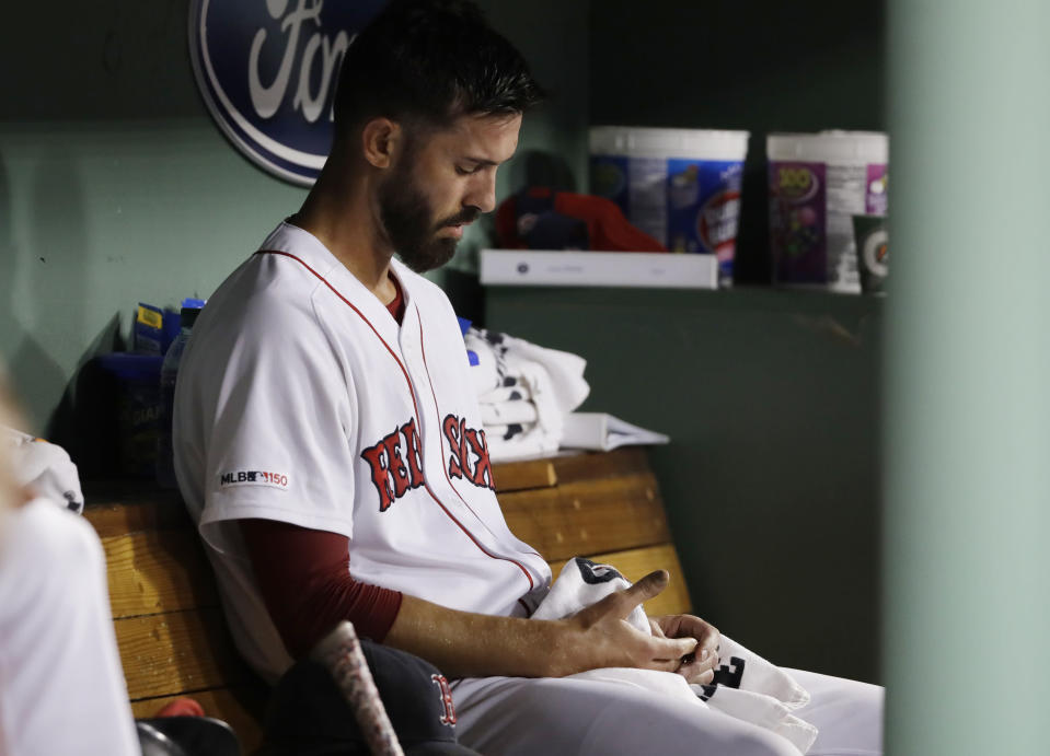 Boston Red Sox starting pitcher Rick Porcello sits in the dugout after being taken out of the baseball game after giving up two home runs to the Minnesota Twins during the fifth inning at Fenway Park, Tuesday, Sept. 3, 2019, in Boston. Porcello allowed six runs in four-plus innings. (AP Photo/Elise Amendola)