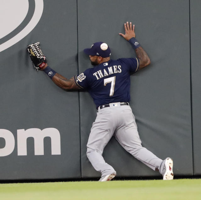 Milwaukee Brewers right fielder Eric Thames (7) cannot come up with a ball hit for a double by Atlanta Braves ' Johan Camargo in the third inning of a baseball game Friday, Aug. 10, 2018, in Atlanta. (AP Photo/John Bazemore)