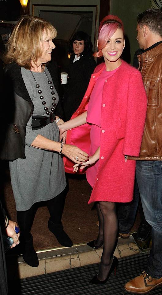 """Across the pond, Russell's wife Katy Perry -- sporting pink hair to match her outfit -- hit the theater in London with her mother-in-law, Barbara Elizabeth. The two saw the musical """"Ghost,"""" but Katy was still thinking about her main squeeze back in New York. """"i know my hubby @rustyrockets is there now...still... reppin us both! Tell him to call his wife if you see him! lolz,"""" she tweeted that night. (10/17/2011)"""