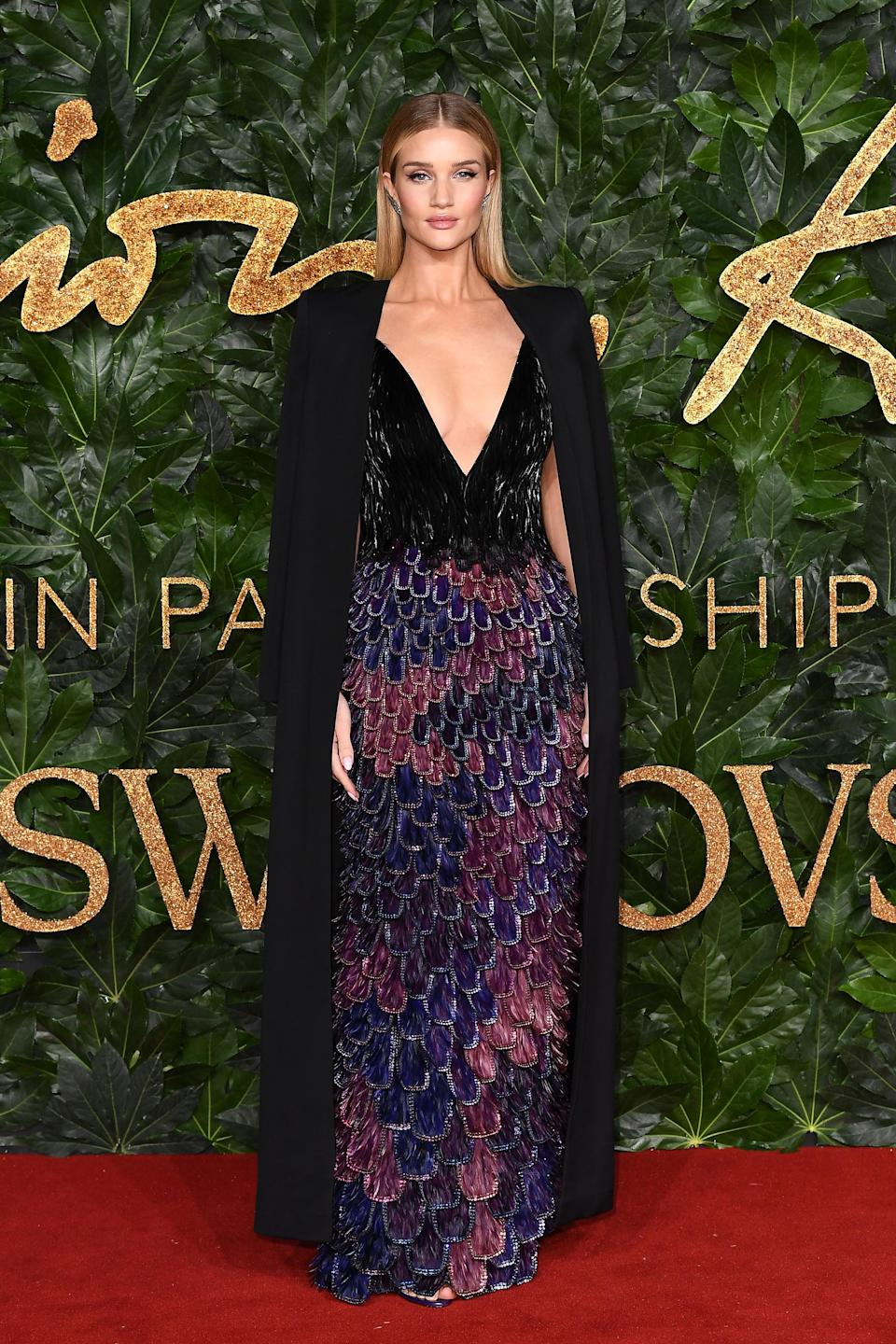 <p>The model and businesswoman wore a multicoloured feathered gown from Givenchy's autumn 2018 collection for the Fashion Awards. <em>[Photo: Getty]</em> </p>
