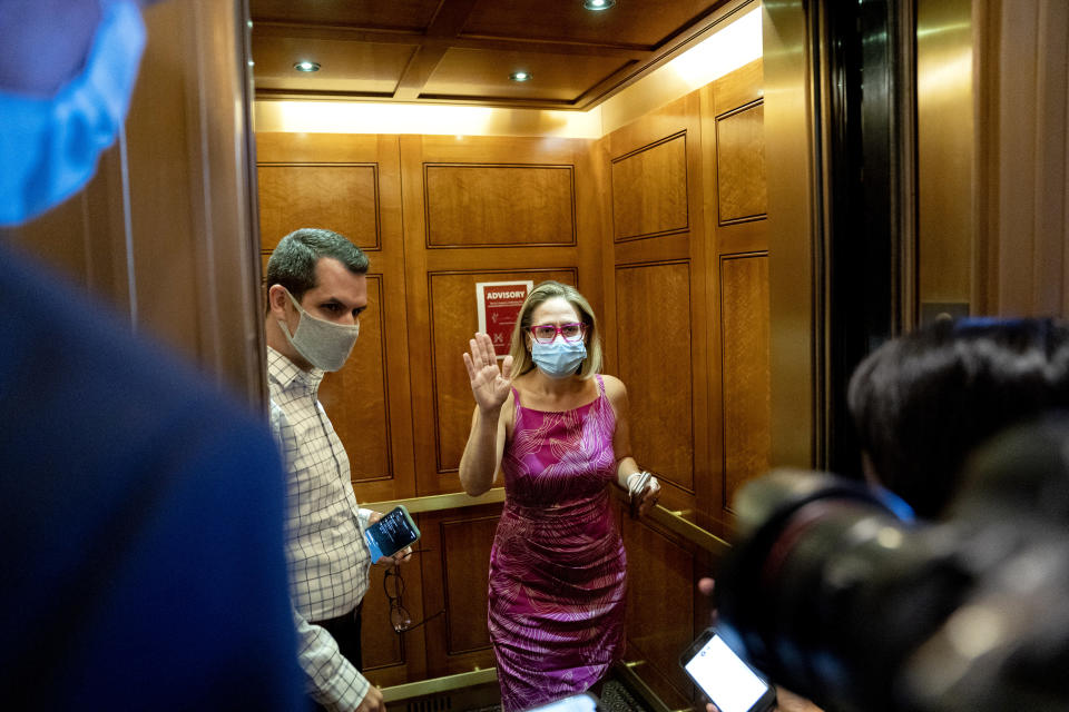 Sen. Kyrsten Sinema (D-Ariz.) speaks to reporters while departing the Senate chamber at the U.S. Capitol on Monday, Sept. 20, 2021. (Stefani Reynolds/The New York Times)