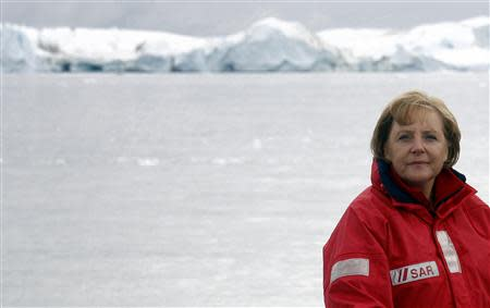 File photo of German Chancellor Angela Merkel standing aboard a ship during a visit to a fjord near Ilulissat in Greenland August 16, 2007. REUTERS/Michael Kappeler/Pool/Files