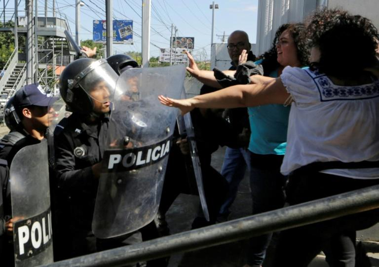 Riot policemen clear journalists from the surroundings of the Plaza El Sol police station as Chamorro (out of frame) tried to speak to National Police Senior Commissioner Francisco Diaz