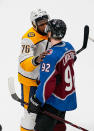 Nashville Predators defenseman P.K. Subban (76) and Colorado Avalanche left wing Gabriel Landeskog (92) talk following the Predators 5-0 series-winning victory over the Avalanche in Game 6 of an NHL hockey first-round playoff series, Sunday, April 22, 2018, in Denver. (AP Photo/Jack Dempsey)