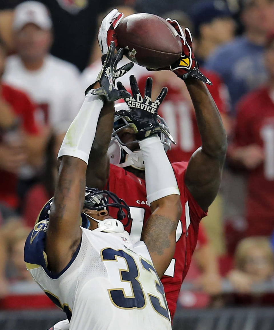 Arizona Cardinals wide receiver John Brown, rear, pulls in a pass over St. Louis Rams cornerback E.J. Gaines (33) during the first half of an NFL football game, Sunday, Nov. 9, 2014, in Glendale, Ariz. (AP Photo/Rick Scuteri)