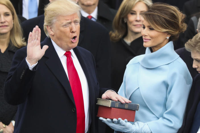<p>Donald Trump is sworn in as the 45th president of the United States as Melania Trump looks on during the 58th Presidential Inauguration at the U.S. Capitol in Washington, Friday, Jan. 20, 2017. (Photo: Andrew Harnik/AP) </p>