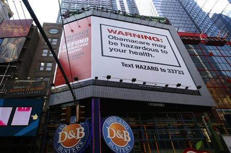"A billboard advertising the defunding of ""Obamacare"" the ACA, paid for by the conservative Heritage Foundation, is pictured in New York"