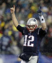 New England Patriots quarterback Tom Brady celebrates LeGarrette Blount's two-yard touchdown run during the second half of the NFL football AFC Championship game against the Indianapolis Colts Sunday, Jan. 18, 2015, in Foxborough, Mass. (AP Photo/Charles Krupa)