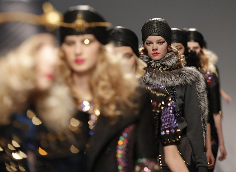 Models present creations by Indian fashion designer Manish Arora fior his Ready to Wear's Fall-Winter 2013-2014 fashion collection, presented Thursday, Feb.28, 2013 in Paris. (AP Photo/Christophe Ena)