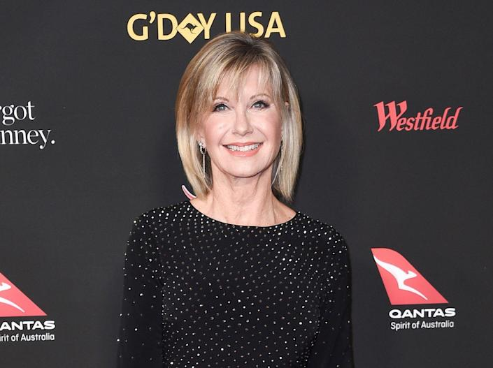 """FILE - In this Jan. 27, 2018 file photo, Olivia Newton-John attends the 2018 G'Day USA Los Angeles Gala at the InterContinental Hotel Los Angeles. Newton-John's autobiography, released last fall in Australia, will out in the U.S. in 2019. Gallery Books, an imprint of Simon & Schuster, announced Tuesday, Dec. 18, that """"Don't Stop Believin'"""" would be published March 12. (Photo by Richard Shotwell/Invision/AP, File)"""
