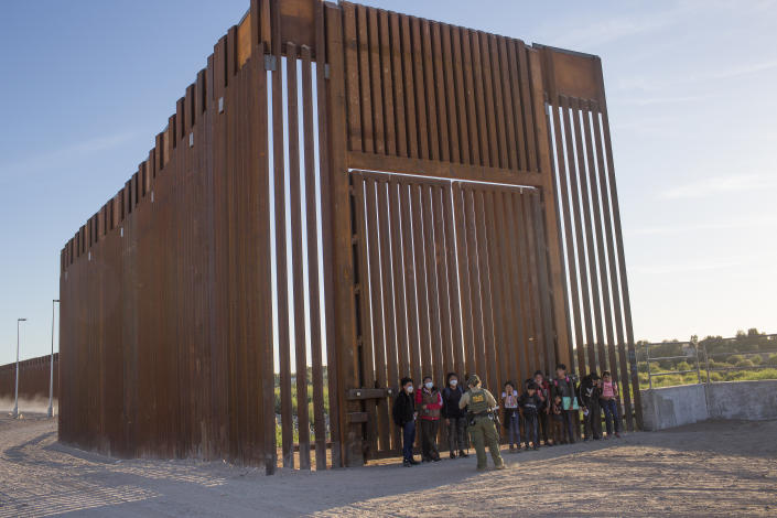 United States Border Patrol agents detain families