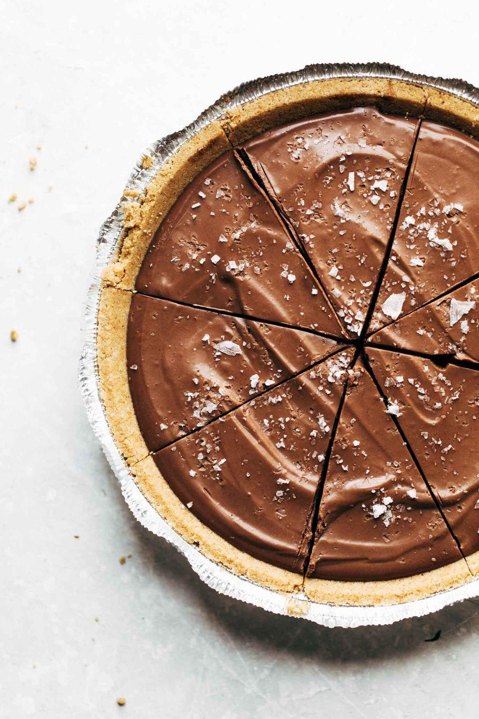 "<p>There's a reason this pie is called ""mind-blowing""—you won't even know it's vegan because of its super-creamy chocolate filling. </p><p><strong>Get the recipe at <a href=""https://pinchofyum.com/vegan-chocolate-pie"" rel=""nofollow noopener"" target=""_blank"" data-ylk=""slk:Pinch of Yum"" class=""link rapid-noclick-resp"">Pinch of Yum</a>.</strong></p><p><strong><a class=""link rapid-noclick-resp"" href=""https://www.amazon.com/Hamilton-Beach-Functions-Dishwasher-58148A/dp/B00EI7DPI0/?tag=syn-yahoo-20&ascsubtag=%5Bartid%7C10050.g.1138%5Bsrc%7Cyahoo-us"" rel=""nofollow noopener"" target=""_blank"" data-ylk=""slk:SHOP BLENDERS"">SHOP BLENDERS</a><br></strong></p>"