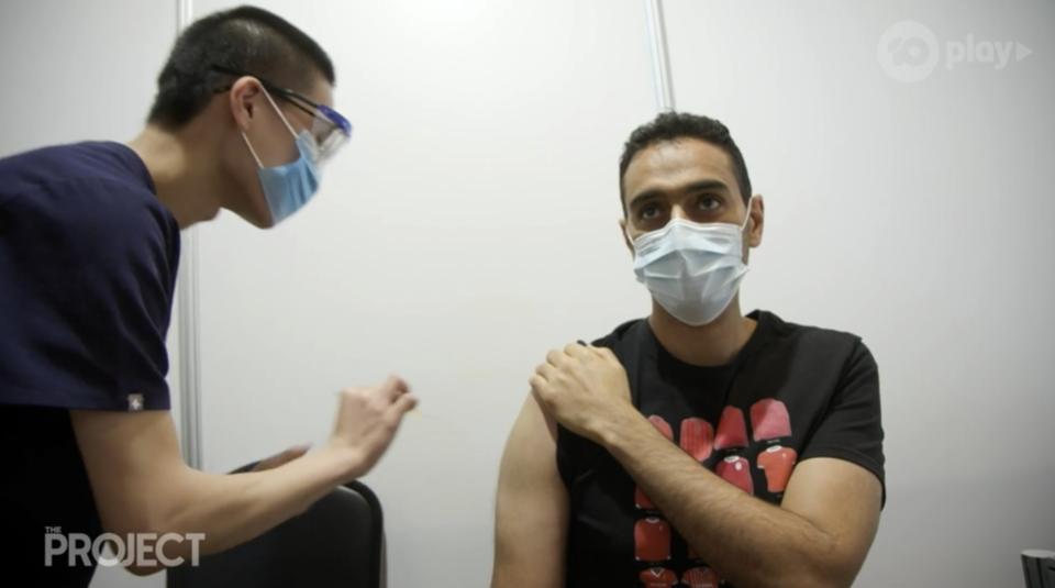 Waleed Aly receiving his Covid vaccine