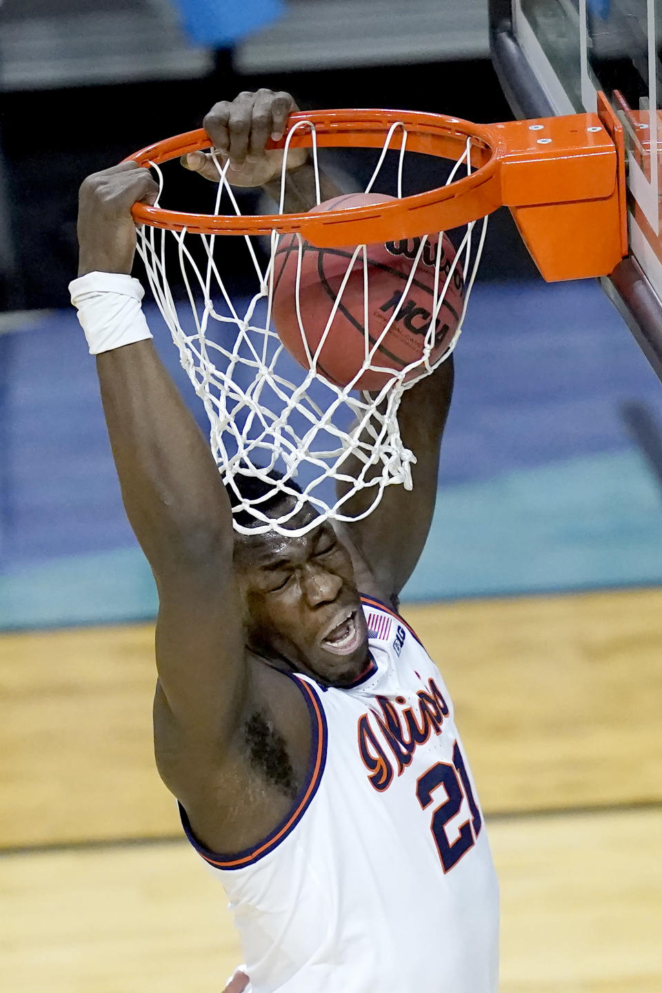 Illinois center Kofi Cockburn dunks the ball during the first half of a first round NCAA college basketball tournament game against Drexel Friday, March 19, 2021, at the Indiana Farmers Coliseum in Indianapolis .(AP Photo/Charles Rex Arbogast)