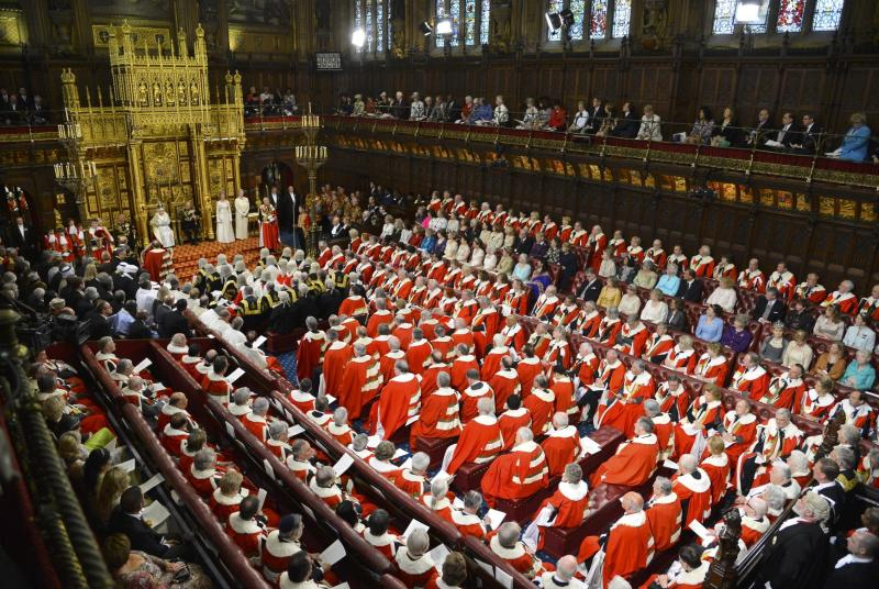 Britain's Queen Elizabeth, rear centre left, delivers her speech at the State Opening of Parliament, in the House of Lords in London Wednesday May 8, 2013.. The State Opening of Parliament marks the formal start of the parliamentary year, the Queen delivered a speech which set out the government's agenda for the coming year. (AP Photo/Toby Melville, Pool)