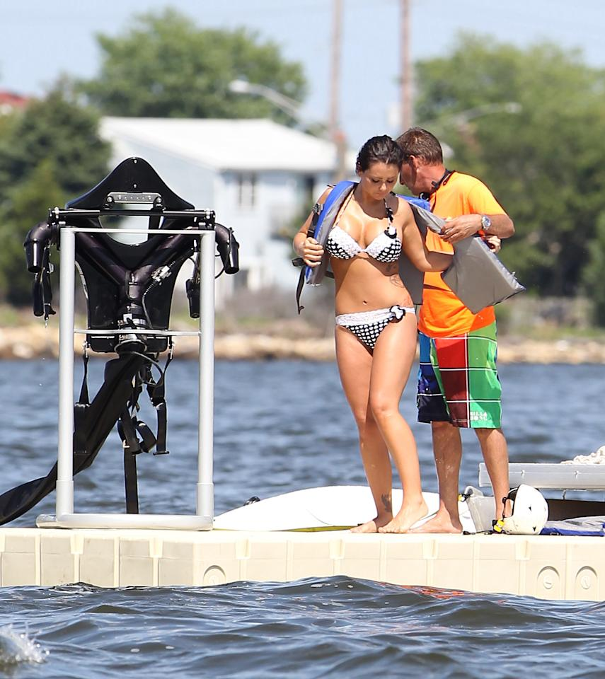 "<b>JWoww</b><br><br>""Jersey Shore"" star JWoww reminds us why she had ""wow"" in her name, squeezing her train-derailing curves into a cute dotted bikini while shooting the latest season of her equally train-wrecking show. And what's that black contraption to the left? The only thing more jaw-dropping than JWoww in a bikini would be JWoww in a bikini flying with a jetpack."