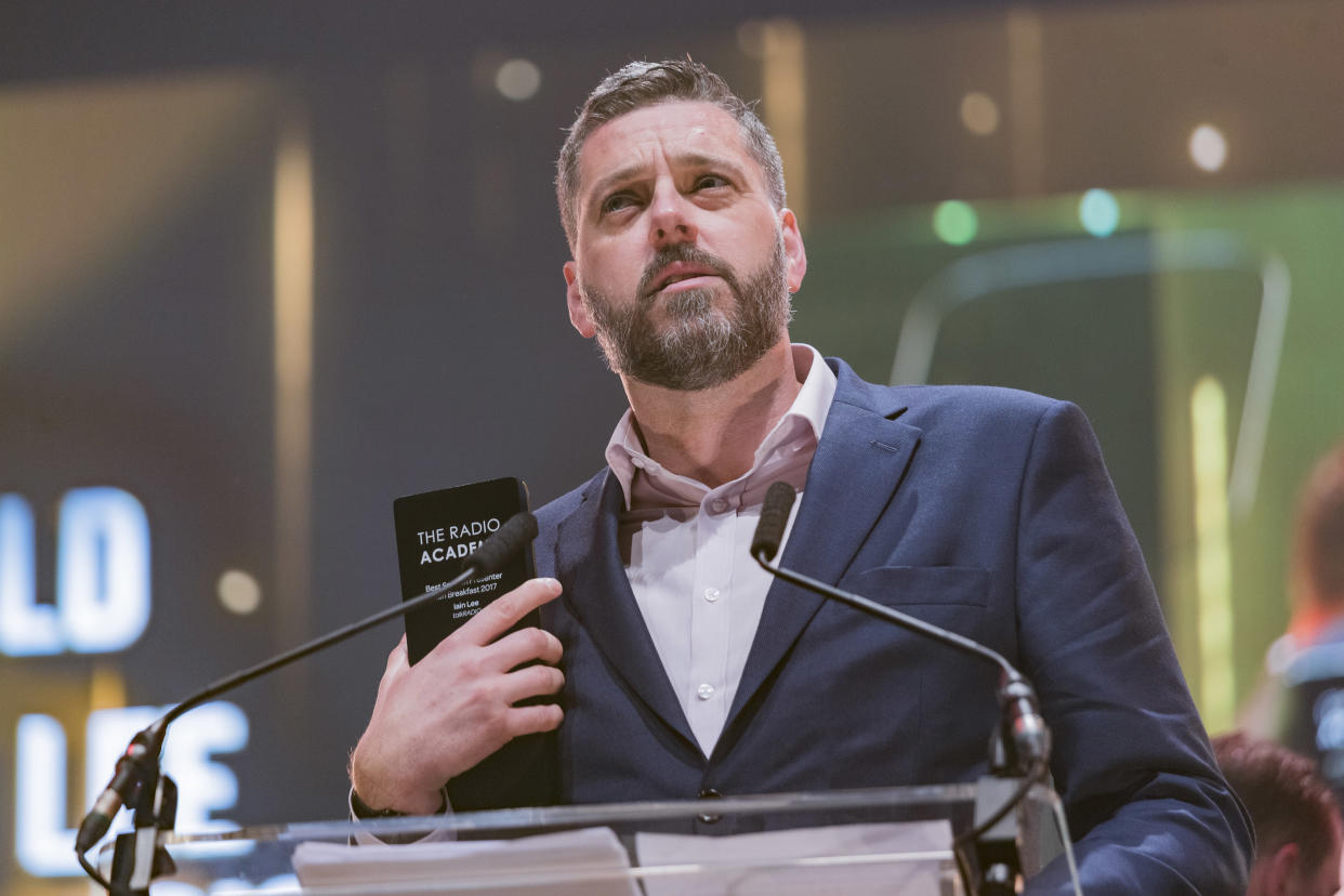LEEDS, ENGLAND - OCTOBER 19:  Iain Lee wins an award at the Audio & Radio Industry Awards at First Direct Arena Leeds on October 19, 2017 in Leeds, England.  (Photo by Andrew Benge/Redferns)