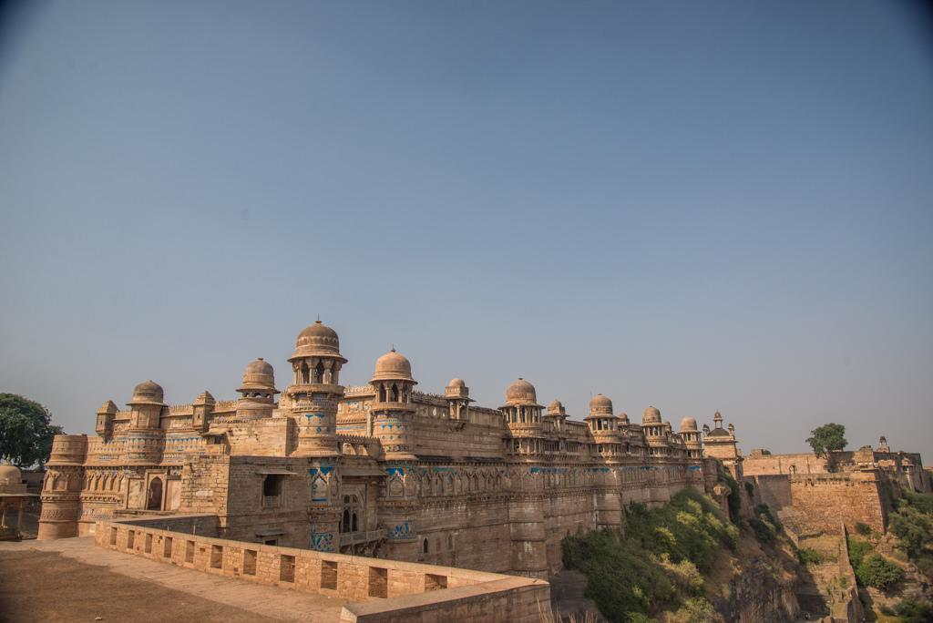 <p>A historically rich city, Gwalior was once the capital of the Scindias and is popular for its majestic forts and beautiful palaces. Take in the imposing Gwalior Fort, built in the eighth century and one of the largest in the country. While here also visit Teli ka Mandir, which at 100 feet is the tallest in Gwalior, and Man Mandir Palace. Spend time at Jai Vilas Palace, built in a mix of grand European styles and has been converted into a museum. Gwalior is also home to the final resting place of one of India's great musicians Tansen. Don't also miss the Sun Temple, Tigra Dam, Gopachal Parvat, Gujari Mahal, and the Saas Bahu Temple. If you want to go on a bit of a road trip, the historic town of Orchha is just a three-hour drive away and has some fascinating monuments of its own including a wildlife sanctuary.<br />Photograph: Saurabh Chatterjee/Flickr </p>