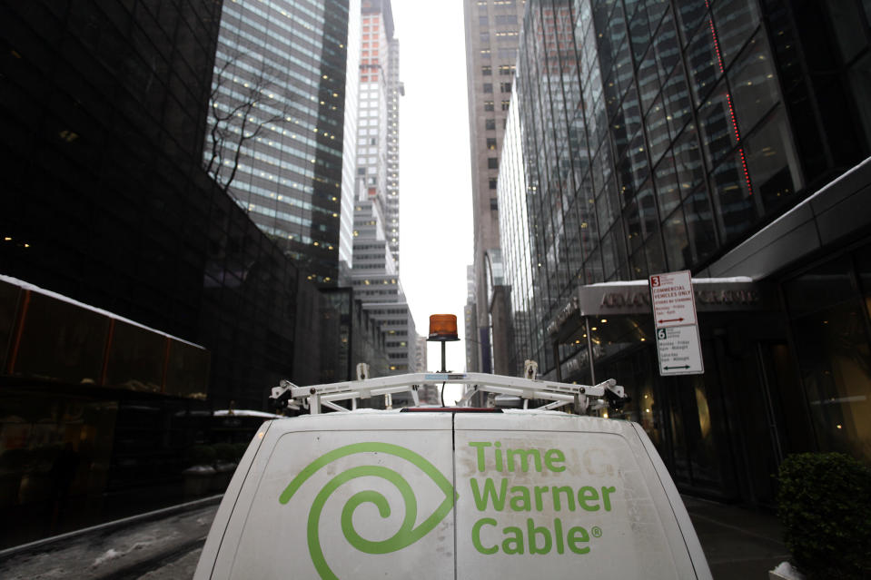 The Time Warner Cable logo is displayed on the back of a van in New York February 13, 2014. (PHOTO: REUTERS/Joshua Lott)