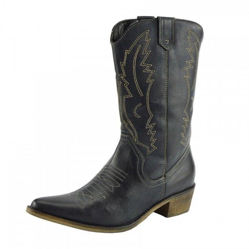 """<br><br><strong>RebelCollections</strong> Black Leather Western Cuban Heel Cowboy Boots, $, available at <a href=""""https://www.etsy.com/uk/listing/804146607/black-leather-western-cuban-heel-outdoor?"""" rel=""""nofollow noopener"""" target=""""_blank"""" data-ylk=""""slk:Etsy"""" class=""""link rapid-noclick-resp"""">Etsy</a>"""