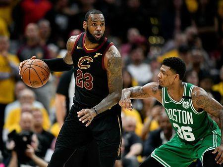 May 21, 2018; Cleveland, OH, USA; Cleveland Cavaliers forward LeBron James (23) drives to the basket against Boston Celtics guard Marcus Smart (36) during the forth quarter in game four of the Eastern conference finals of the 2018 NBA Playoffs at Quicken Loans Arena. Mandatory Credit: David Richard-USA TODAY Sports