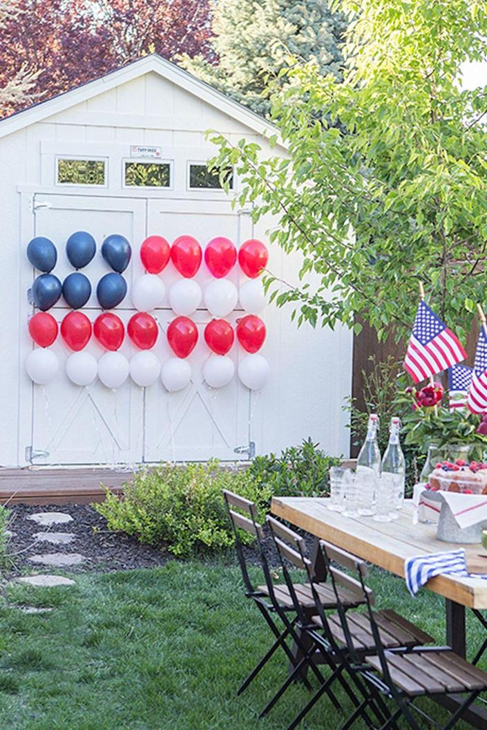 """<p>Enlist your family to help you blow up these balloons, then use tape to stick them in place. </p><p><em>Get the tutorial from <a href=""""https://www.ellaclaireinspired.com/patriotic-balloon-flag/"""" rel=""""nofollow noopener"""" target=""""_blank"""" data-ylk=""""slk:Ella Claire Inspired"""" class=""""link rapid-noclick-resp"""">Ella Claire Inspired</a>.</em></p><p><strong><strong>What You'll Need:</strong> </strong><a href=""""https://www.amazon.com/100-Premium-Quality-Balloons-decoration/dp/B06VTTT8PF/?tag=syn-yahoo-20&ascsubtag=%5Bartid%7C10070.g.2446%5Bsrc%7Cyahoo-us"""" rel=""""nofollow noopener"""" target=""""_blank"""" data-ylk=""""slk:Balloons"""" class=""""link rapid-noclick-resp"""">Balloons</a> ($13 for 100, Amazon)</p>"""