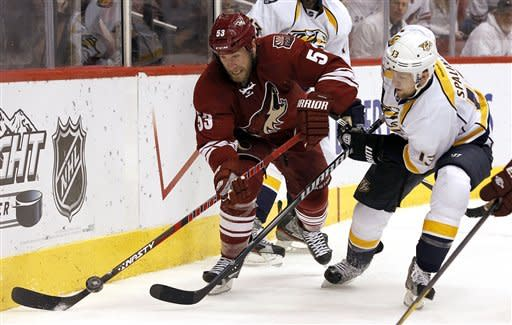 Phoenix Coyotes' Derek Morris (53) and Nashville Predators' Nick Spaling (13) vie for the puck in the second period during Game 5 in an NHL hockey Stanley Cup Western Conference semifinal playoff series Monday, May 7, 2012, in Glendale, Ariz. (AP Photo/Ross D. Franklin)