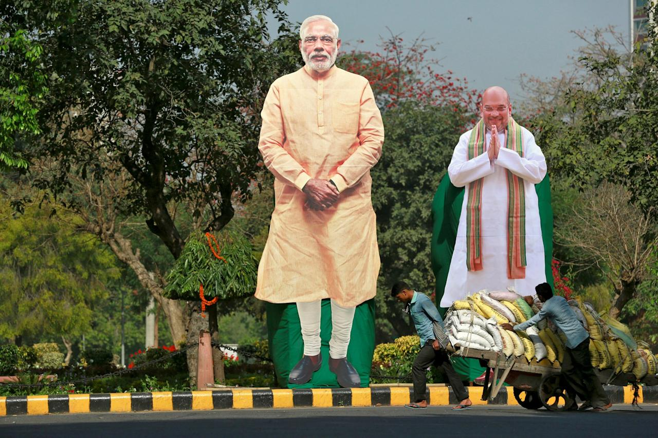 <p>Giant cardboard cut outs of<span> India</span>n Prime Minister Narendra Modi (C) and Bharatiya Janata Party president Amit Shah are displayed in New Delhi,<span> India</span>, March 15, 2017. </p>