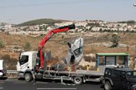 Car is removed from the scene of what Israeli military said is a car-ramming attack near the settlement of Elazar in the Israeli-occupied West Bank