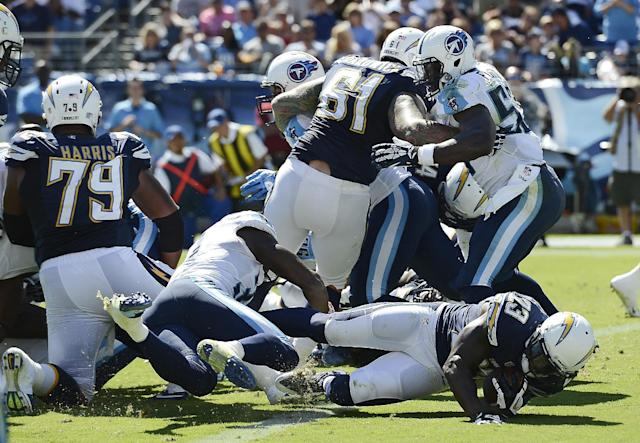 San Diego Chargers running back Ronnie Brown (23) scores a touchdown on a 1-yard run against the Tennessee Titans in the third quarter of an NFL football game on Sunday, Sept. 22, 2013, in Nashville, Tenn. (AP Photo/Mark Zaleski)