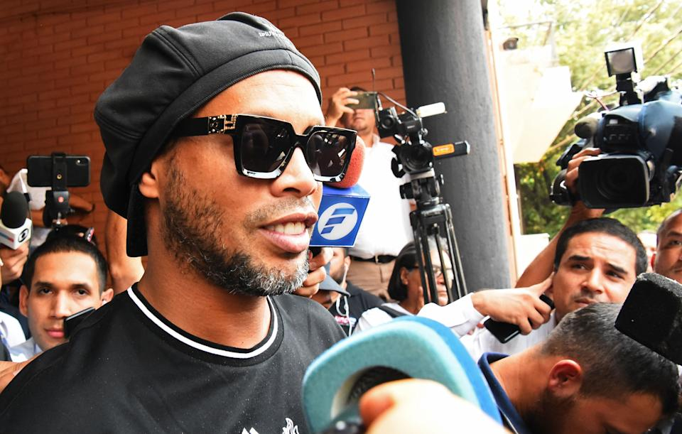 Brazilian retired football player Ronaldinho leaves Asuncion's Prosecution after declaring about his irregular entry to the country, in Asuncion, Paraguay, on March 5, 2020. - Former Brazilian football star Ronaldinho and his brother have been detained in Paraguay after allegedly using fake passports to enter the South American country, authorities said Wednesday. (Photo by NORBERTO DUARTE / AFP) (Photo by NORBERTO DUARTE/AFP via Getty Images)