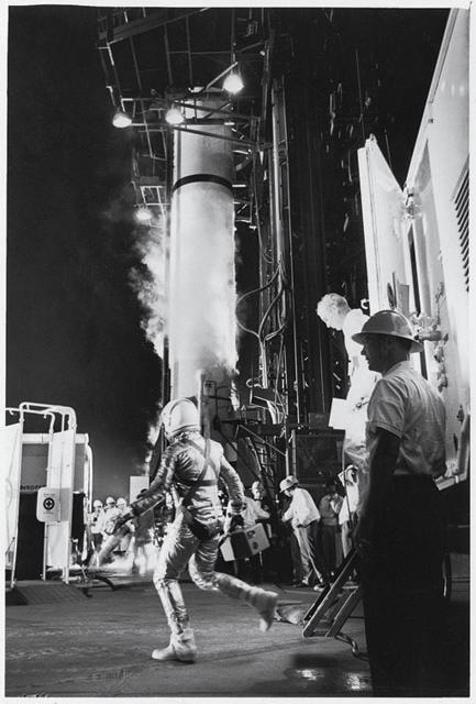 """Navy Cmdr. Alan Shephard hurries toward a Redstone rocket booster in the predawn hours of May 5, 1961. Shephard's trip lasts only about 15 minutes, but by the time he is aboard ship, having been recovered after splashing down in the ocean, he is officially the first American to have gone into space. RALPH MORSE/LIFE  <a href=""""http://life.com/books/75years""""> LIFE 75 Years: The Very Best of LIFE</a>"""