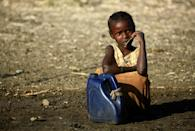 An Ethiopian girl who fled fighting in Tigray sits at a refugee transit centre in Sudan; fighting in Tigray has left some 2.3 million children in urgent need of assistance and thousands more at risk in refugee camps, the UN children's agency says