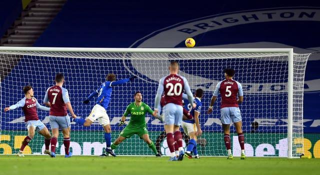 Alexis Mac Allister heads over the crossbar for the hosts