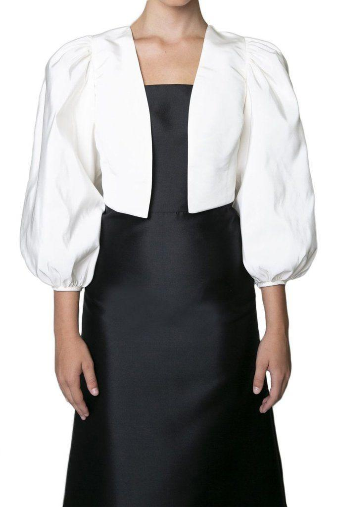 """<p>overthemoon.com</p><p><strong>$625.00</strong></p><p><a href=""""https://overthemoon.com/products/bonnie-jacket-in-white?variant=39290798407874"""" rel=""""nofollow noopener"""" target=""""_blank"""" data-ylk=""""slk:Shop Now"""" class=""""link rapid-noclick-resp"""">Shop Now</a></p><p>Subtle balloon sleeves give this cropped number flair—and it's a great option for bridesmaids too.</p>"""