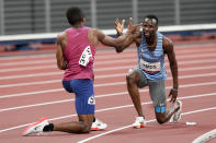 Isaiah Jewett, of the United States, and Nijel Amos, right, of Botswana, shake hands after falling in the men's 800-meter semifinal at the 2020 Summer Olympics, Sunday, Aug. 1, 2021, in Tokyo. (AP Photo/Jae C. Hong)