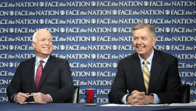 """In this Sunday, March 3, 2013, photograph provided by CBS News Sen. John McCain, R–Ariz., and Sen. Lindsey Graham, R–S.C., right, are interviewed on CBS's """"Face the Nation"""" in Washington. Graham and McCain said Sunday that they want answers from the Obama administration about what happened at the U.S. Consulate in Benghazi, Libya, last September that left four Americans dead, and that they are willing to oppose the nomination of a new CIA director, John Brennan, until they get them."""" (AP Photo/CBS News, Chris Usher)"""