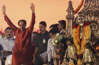 Shiv Sena party leader Uddhav Thackeray, left, waves to supporters as he arrives to takes oath as Maharashtra chief minister in Mumbai, Thursday, Nov. 28, 2019. Supporters of the Shiv Sena, Nationalist Congress Party (NCP) and the Congress party thronged Shivaji Park to watch their leaders take oath of office. (AP Photo/Rafiq Maqbool)