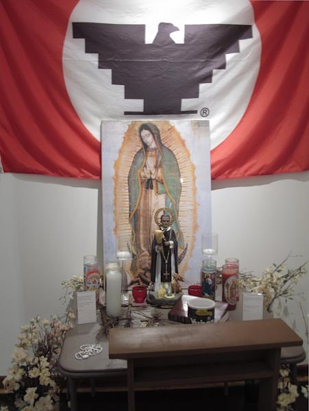 In this photo taken Tuesday Oct. 2, 2012, the United Farm Workers of America flag and the Virgin of Guadalupe statue are part of an exhibit in the visitor center at La Paz, the property that served as the home and planning center of Chicano leader Cesar Chavez and his farmworker movement starting in the 1970's in Keene, Calif. Today, the foothills of the Tehachapi mountains continue to house the United Farm Workers of America headquarters and memorials to Chavez, though farmworkers no longer live there. Presiden Obama is designating parts of the property as a national monument and visiting the site on Monday, a move seen as likely to shore up support from Hispanic and progressive voters just five weeks before the election. (AP Photo/Gosia Wozniacka)