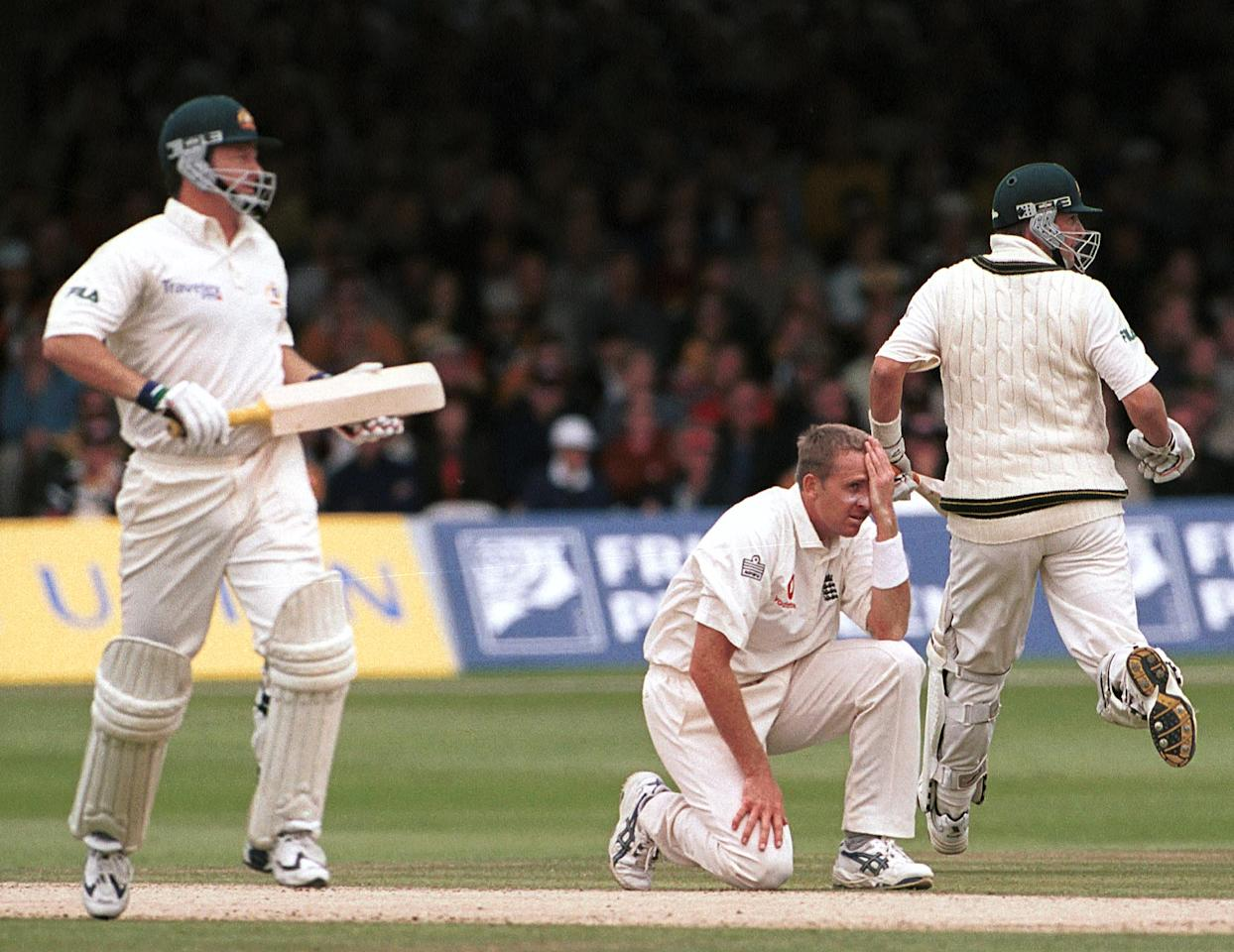 20 Jul 2001:  A dejected Dominic Cork of England as Mark Waugh and brother Steve Waugh of Australia clock up the runs during the second day of the Second Npower Test between Engalnd and Australia at Lord's, London.   Mandatory Credit: Craig Prentis/ALLSPORT