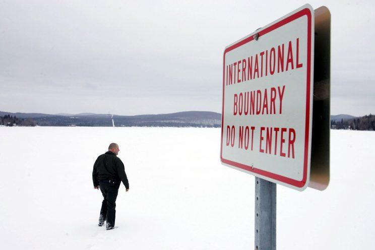 A U.S. Border Patrol Agent walks onto a frozen lake near Norton, Vermont that is split between Canada and the U.S. Some Canadians say they will boycott travel to the U.S. in protest of Trump's travel ban. Photo from Getty Images