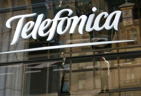 FILE PHOTO: Reflections are seen on a logo of Spain's telecommunications giant Telefonica in Madrid